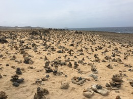 Beach filled with cairns